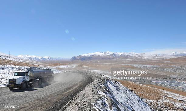 A picture taken on October 1 shows a truck riding along a road near the Kumtor gold mine in the Tien Shan Mountains 4000 meters above the sea level...