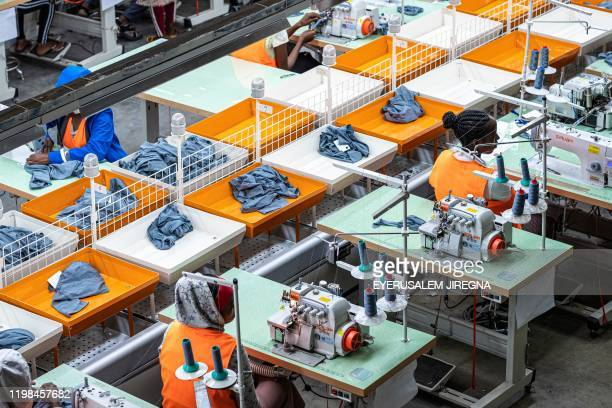 Picture taken on October 1 shows workers operating sewing machines in a garment factory at the Hawassa Industrial Park in Hawassa, southern Ethiopia....