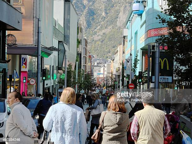 A picture taken on October 10 2015 shows people walking in a shopping street in Andorra La Vella in the east Pyrenees between France and Spain AFP...