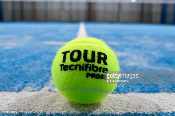 A picture taken on October 10 2017 in Bois d'Arcy near Paris shows a padel ball on a padel court Tennis champions like Nadal and Monfils have raise a...