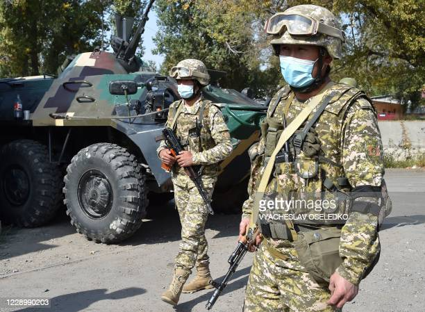 Picture taken on October 10, 2020 shows servicemen at a checkpoint set on the outskirts of Bishkek following president Jeenbekov's declaration of a...