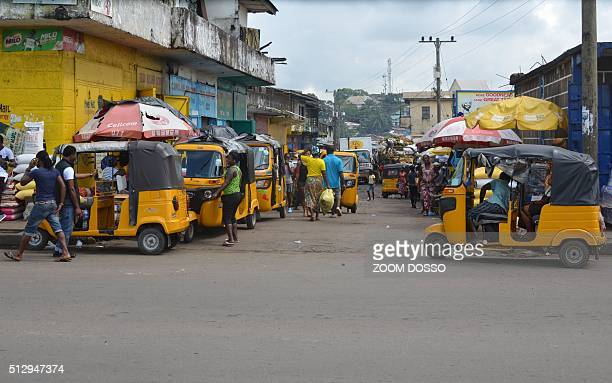 Picture taken on October 10 shows auto-rickshaws in the streets of Monrovia. Omnipresent on the chaotic streets of Mumbai, Jakarta and Bangkok,...