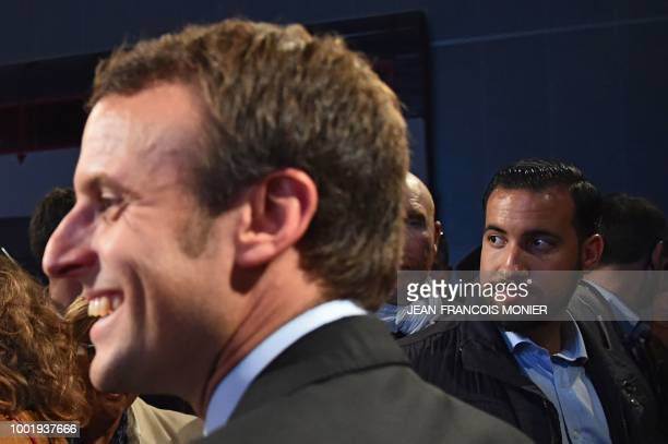 A picture taken on October 11 2016 shows Head of Security Alexandre Benalla looking on next to then French presidential election candidate for the En...