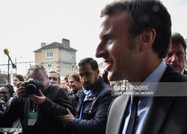 A picture taken on October 11 2016 shows then French presidential election candidate for the En Marche movement Emmanuel Macron Head of Security...