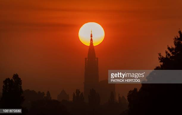 TOPSHOT A picture taken on October 11 2018 in Strasbourg eastern France shows NotreDame cathedral at sunrise The so called 'Strasbourghenge' which...