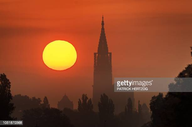 A picture taken on October 11 2018 in Strasbourg eastern France shows NotreDame cathedral at sunrise The so called 'Strasbourghenge' which refers to...
