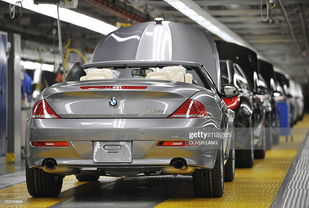 Picture taken on October 12, 2009 shows series 6 cars of German carmaker BMW being processed at the company's plant in the southern German city of Dingolfing. German luxury car group BMW said on June 9, 2010 that its unit sales gained 10.8 percent last month from the May 2009 level, and that the BMW brand remained the world's leading premium automobile.