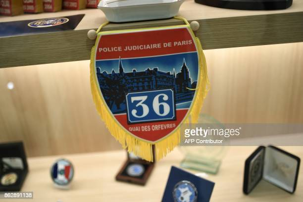 A picture taken on October 12 2017 shows an old police blazon of the ' 36 Quai des Orfevres' at the new Paris Judiciary Police headquarters in Paris...