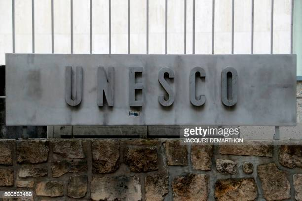 A picture taken on October 12 2017 shows the logo of the United Nations Educational Scientific and Cultural Organisation headquarters in Paris The...