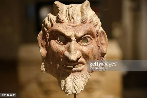 A picture taken on October 13 shows a mask of Satyr a Greek mythological creature with goatlike features displayed in the newly inaugurated basement...