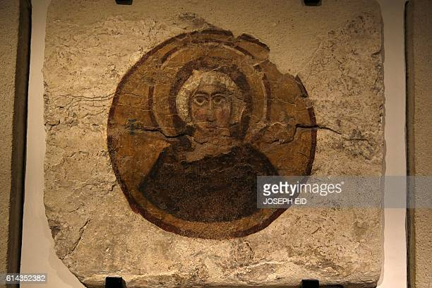 A picture taken on October 13 shows a painted facade of a tomb from the Roman necropolis of Tyre displayed in the newly inaugurated basement section...