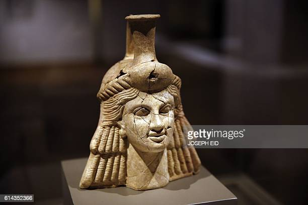 A picture taken on October 13 shows an anthropomorphic vase displayed in the newly inaugurated basement section of Beirut's National Museum The...