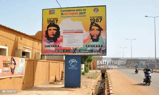 A picture taken on October 14 2017 in a street of Ouagadougou shows a poster celebrating former President Thomas Sankara known as Africa's Che...