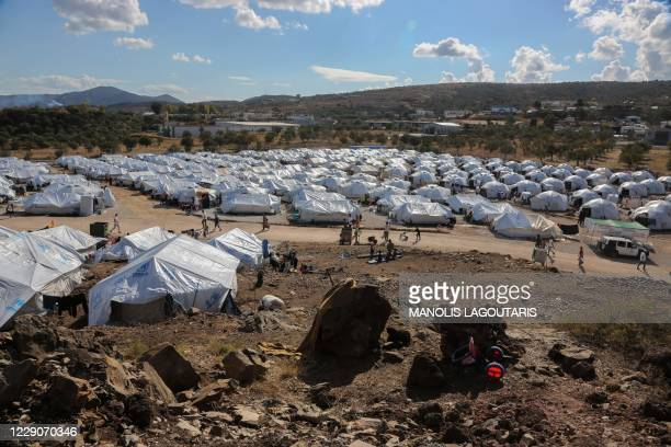 Picture taken on October 14, 2020 shows the Kara Tepe camp for refugees and migrants on the island of Lesbos. - Greece will build a new permanent...