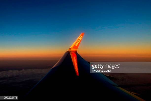 A picture taken on October 14 shows the wing of an EasyJet plane during a flight over Italy