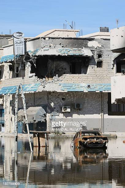 A picture taken on October 15 2011 shows the warbattered Dollar district in central Sirte during battles between National Transitional Council...