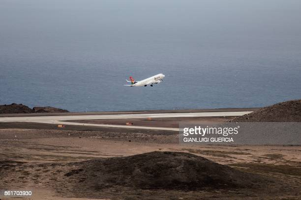 TOPSHOT A picture taken on October 15 2017 shows the first Inaugural Commercial plane from Johannesburg taking off at the newly built Saint Helena...