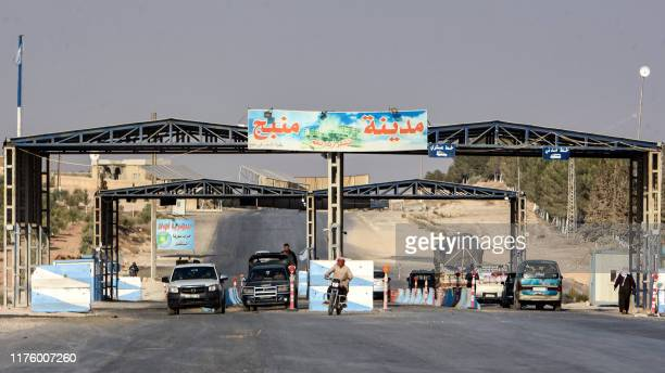 Picture taken on October 15, 2019 shows an entrance to the town of Manbij, which is now controlled by Syrian regime forces. - Kurdish fighters...