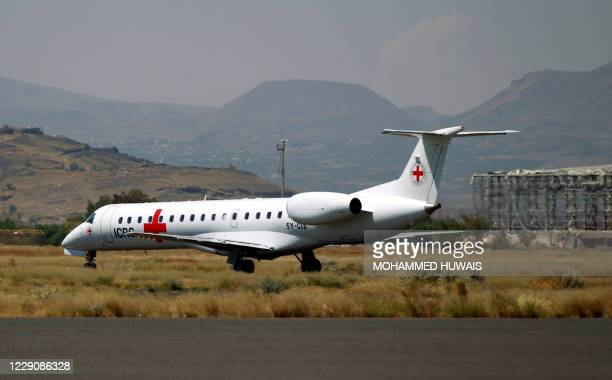Picture taken on October 15, 2020 shows an Embraer ERJ-145LR aircraft used by the International Committee of the Red Cross carrying prisoners who...