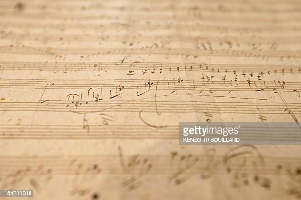 A picture taken on October 16 2012 at Sotheby's auction house in Paris shows German composer and pianist Ludwig van Beethoven handwritten partition...
