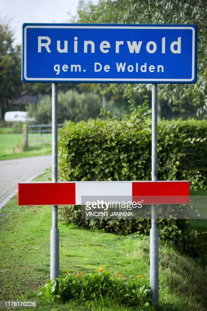 Picture taken on October 16, 2019 shows the road sign of the village of Ruinerwold, where in a remote area of northern Netherlands' province of...