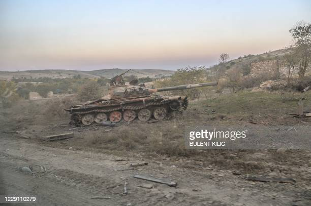 Picture taken on October 16, 2020 shows a destroyed tank in the city of Jabrayil, where Azeri forces regained control during the fighting over the...