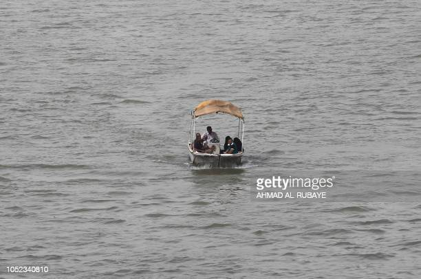 A picture taken on October 16 shows Iraqi riding their boats on the Tigris river in the capital Baghdad