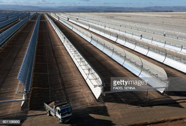 MAKHFI A picture taken on October 17 2015 shows a truck driving past solar mirrors at the Noor 1 Concentrated Solar Power plant some 20km outside the...