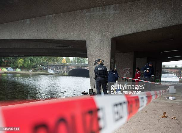 Picture taken on October 17 2016 shows police working under a bridge in Hamburg northern Germany where a 16 year old was stabbed The Islamic State...
