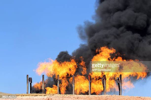 A picture taken on October 17 2017 shows excess flammable gasses burning from gas flares at the Havana oil field west of the multiethnic northern...