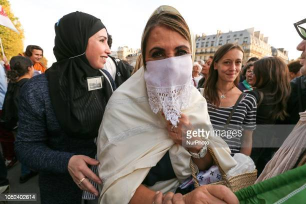 A picture taken on October 17 2018 shows a woman wearing the Hayek a traditional Algerian veil usually associated with the Casbah area of Algiers on...