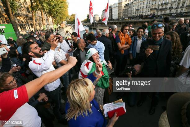 A picture taken on October 17 2018 shows people gathering on the SaintMichel Bridge in Paris during a rally to commemorate a demonstration by...