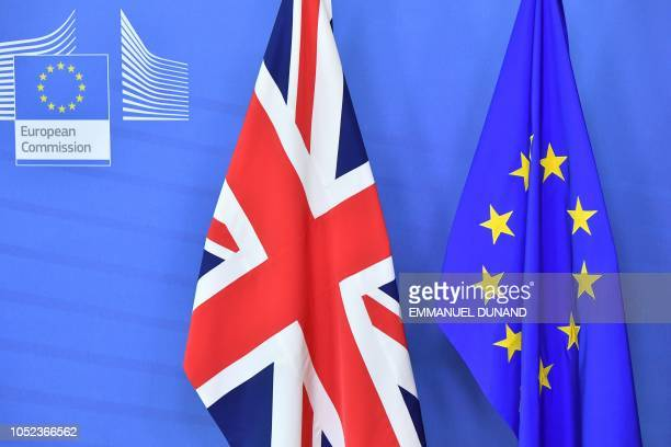 A picture taken on October 17 2018 shows the United Kingdom flag set past the EU flag before the arrival of Britain's Prime Minister Theresa May and...