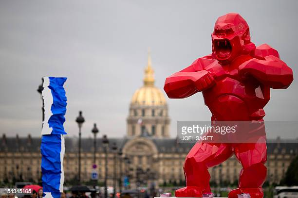 A picture taken on October 18 2012 shows a sculpture entitled 'Gorille rouge' by French artist Richard Orlinski and a sculpture by French artist...