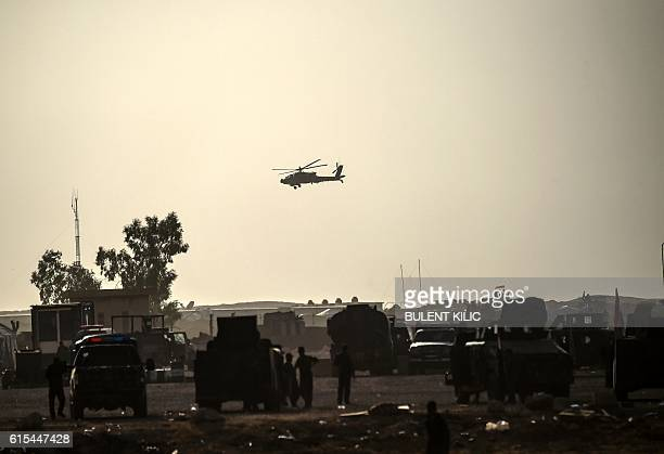 A picture taken on October 18 2016 shows a helicopter prowling the perimeter of the Qayyarah military base about 60 kilometres south of Mosul Tens of...