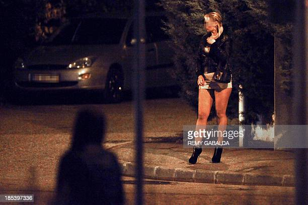 A picture taken on October 19 2013 shows a prostitute at the Boulevard de Suisse in Toulouse southwestern France AFP PHOTO / REMY GABALDA