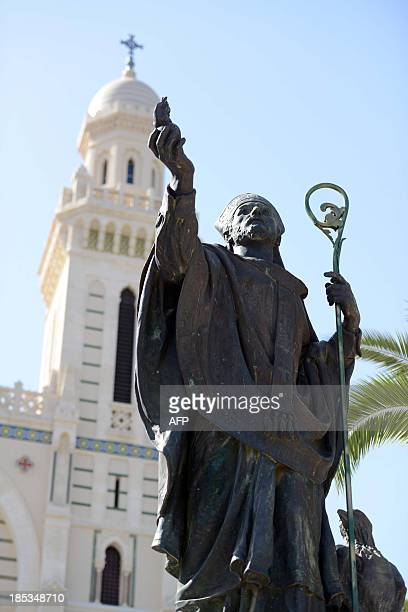 A picture taken on October 19 2013 shows a statue of SaintAugustin in front of the SaintAugustin basilica after its reopening in the Algeria's...