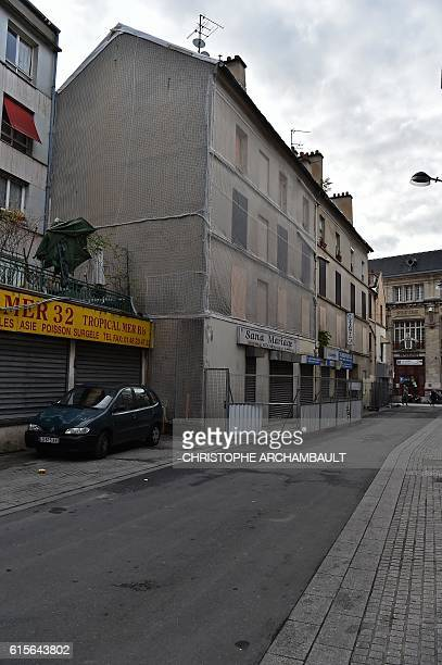 A picture taken on October 19 2016 shows a man walking past the building where French Police special forces raided an apartment on November 18 2015...