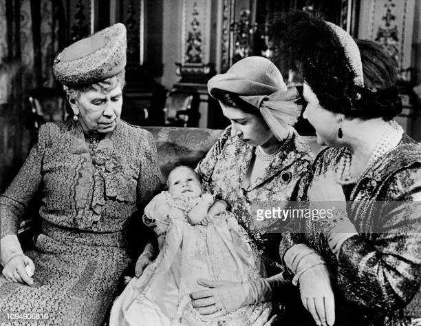 Picture taken on October 1950 at London showing Queen Elizabeth II helding in arms Princess Anne surrounded by Queen Mary and the Queen Mother Queen...