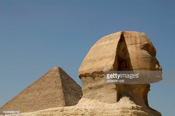 A picture taken on October 2 shows a view of the Great Pyramid of Khufu and the Sphynx on the Giza Plateau on the southwestern outskirts of the...