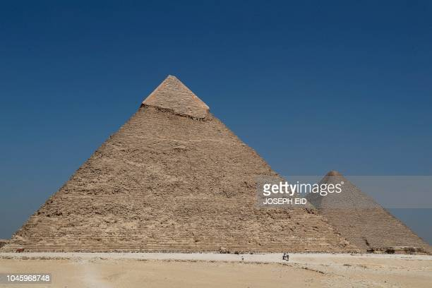 A picture taken on October 2 shows a view of the pyramid of Khafre and the Great Pyramid of Khufu on the Giza Plateau on the southwestern outskirts...
