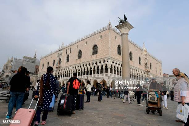 A picture taken on October 20 2017 in Venice shows tourists arriving in front of the 'Palazzo Ducale' at St Mark's square A referendum will be held...