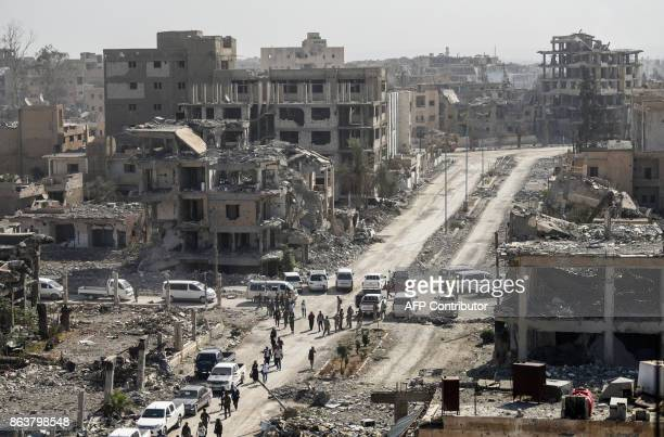 A picture taken on October 20 shows a general view of heavily damaged buildings in Raqa after a Kurdishled force expelled Islamic State group...