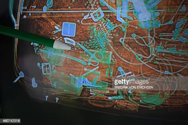 Picture taken on October 21 2010 shows an xrayed luggage piece containing nail scissors at the security control of the airport in Frankfurt am Main...