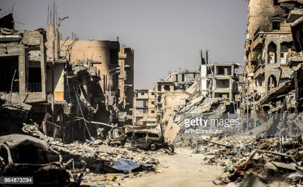 TOPSHOT A picture taken on October 21 2017 shows a general view of heavily damaged buildings in Raqa after a Kurdishled force expelled the Islamic...