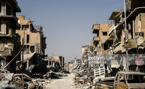 A picture taken on October 21 2017 shows a general view of heavily damaged buildings in Raqa after a Kurdishled force expelled the Islamic State...