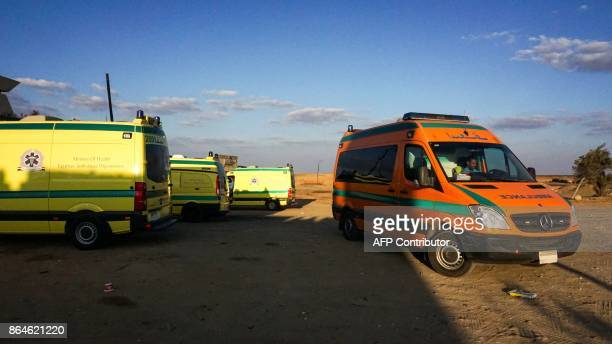 A picture taken on October 21 2017 shows ambulances parked in the desert towards the Bahariya oasis in Egypt's Western desert about 135 kilometres...