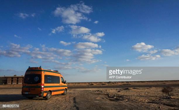 A picture taken on October 21 2017 shows an Egyptian Health Ministry ambulance parked in the desert towards the Bahariya oasis in Egypt's Western...