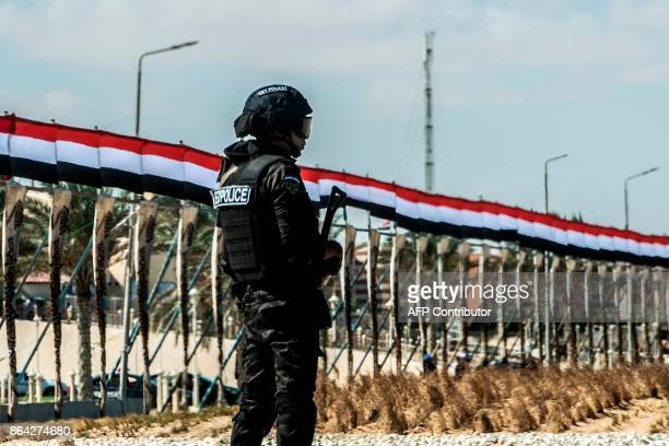 A picture taken on October 21 2017 shows an Egyptian policeman standing guard in the new city of elAlamien west of Alexandria At least 35 Egyptian...