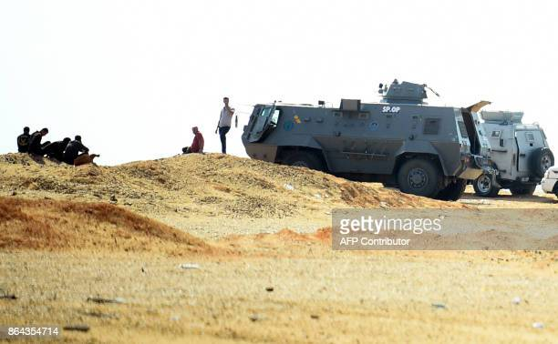 A picture taken on October 21 2017 shows an Egyptian security forces' armoured personnel carrier parked on the desert road towards the Bahariya oasis...